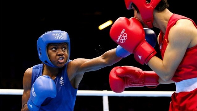 Nicola Adams of Great Britain in action against Ren Cancan of China