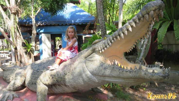 The Big Crocodile & Little Girl Crocodile statue with knife like teeth i...