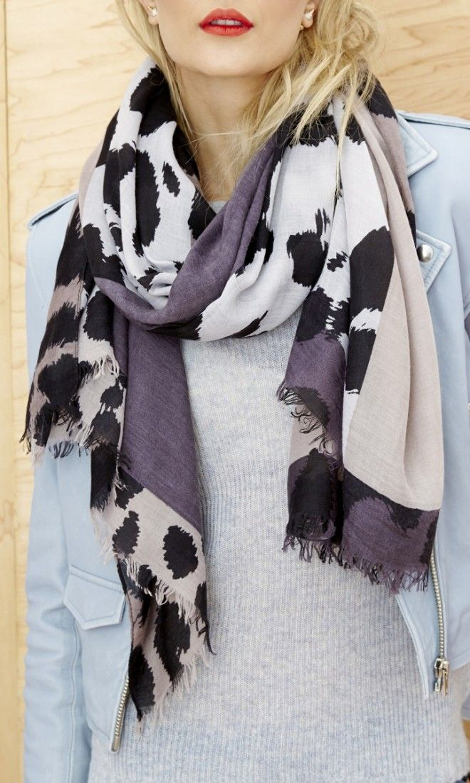 An artfully spotted and violet-and-black scarf with a super soft feel