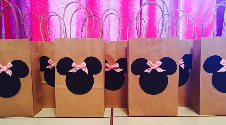 Minnie Mouse candy bags. Google print outs, pink ribbon, glue gun, and 10pack brown bags from walmart.