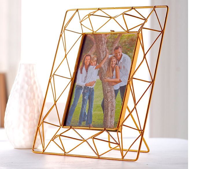 """Copper Colour Photoframe 4X6 inch.   Copper coloured geometric style photo frame. Holds one 6x4"""" photo. Frame size of H24 x W19cm."""