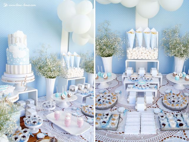 Blue and white with big balloon clouds for this Stars and Clouds birthday themed party