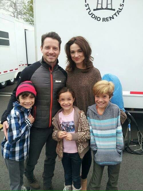 Crystal Reed, Ian Bohen & some kids.