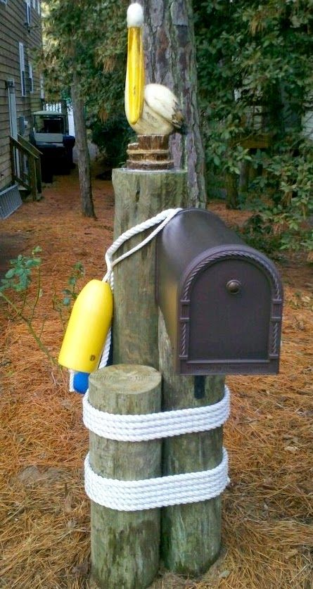 Like this one in the right place. I'd go for an old buoy and old looking rope and a larger pelican.