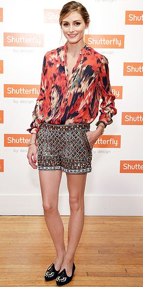 OLIVIA PALERMO The style-setter's unexpected mix of prints usually lands her a spot in our Love Her Outfit gallery. This time she pairs a bold red patterned blouse with heavily embellished shorts and embroidered flats to host a Shutterfly By Design event in N.Y.C.