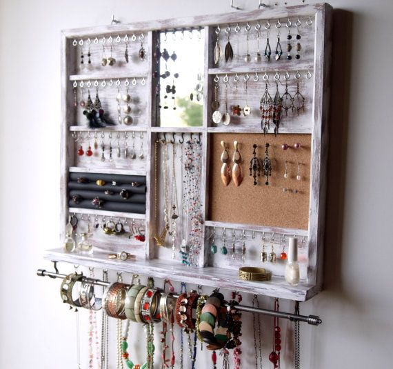 This is a jewelry organizer designed and crafted by me. Functional with an artistic flare is my goal when making functional pieces. Something you can use every day and be well-pleased to display in your bedroom or elsewhere as a piece of art. Designed on a White distressed background, is meant to hold most of your jewelry in a way you can reach them easily. Has chrome hooks for about 100 earrings of any length, then a large bracelet bar and a ring box for more than 15 rings , along with a…