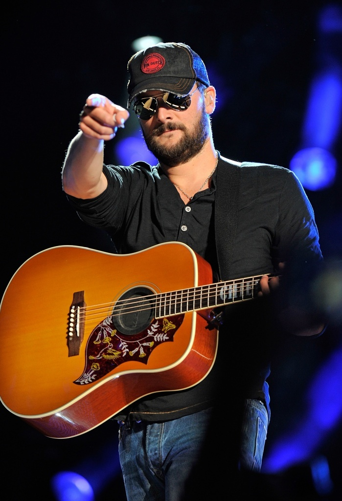 Eric Church,  Eric Church performs at LP Field during the 2013 CMA Music Festival on June 6, 2013 in Nashville, Tennessee. (Photo by Frederick Breedon IV/WireImage), 2013