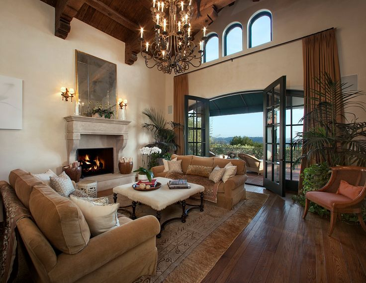 Mediterranean Living Room With Galleon Bronze Two Tier Wooden Candle 12 Light Chandelier High Ceiling French Doors