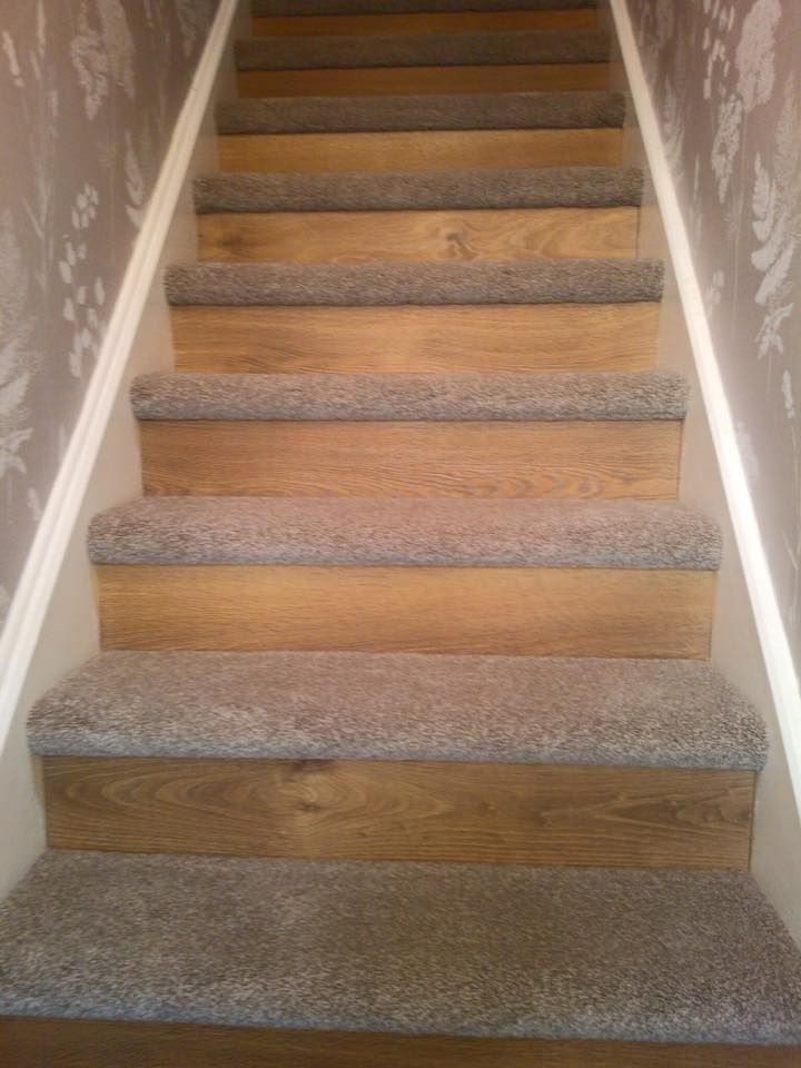 Starting a new trend Oak laminate flooring to the riser and new thick saxony carpet onto tread. Transforming an old staircase in something fashionable and different.