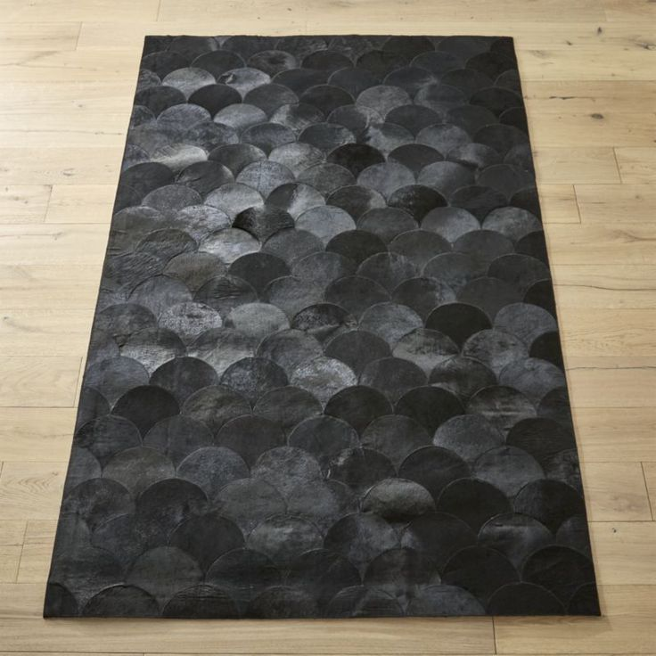 Shop Scallop Black Hide Rug.   Layers of chic hide-on-hair leather scallops add a sophisticated fanfare to the floor.  Rich hide creates a luxurious foundation for any living space.  Due to nature of hide, rugs range from brown black to true black.
