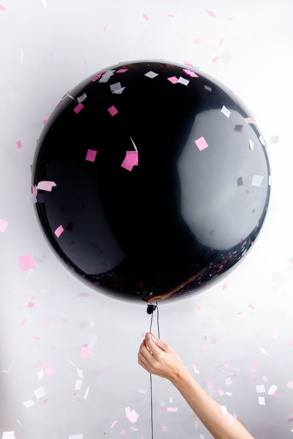 "One jumbo 36"" black balloon pre-filled with pink or blue party confetti — sure to make an impact at your gender reveal party! We use the highest quality latex balloons and our custom confetti blends,"