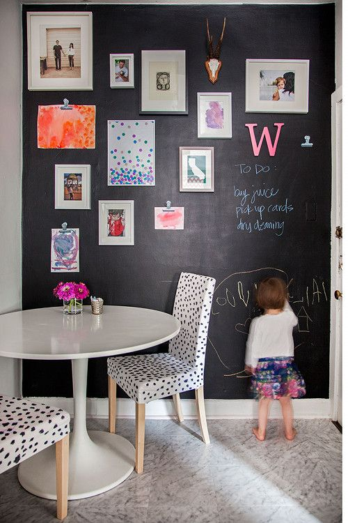 Image above: I wanted to spice up our galley kitchen with a fun gallery wall for Olivia. I painted the back wall with chalkboard paint and hung frames and bulldog clips for displaying artwork. We replaced the old linoleum with my favorite cheap flooring fix, Armstrong vinyl tile in Crescendo. The leopard chairs were a DIY with Sharpie on solid cream Ikea chairs.