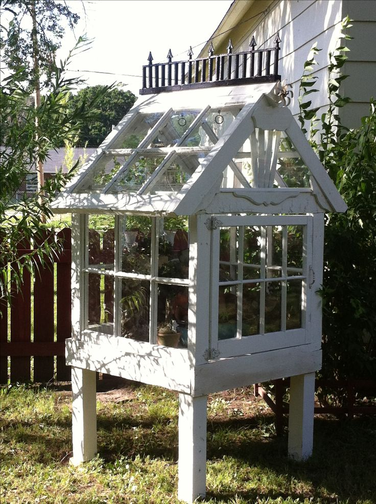 Small Victorian Greenhouse I made completely from reclaimed materials. I used an old bunk bed, a broke chair. Old windows, plastic garden edging, old hindges, and an odd metal thing for a whirlygig. $150