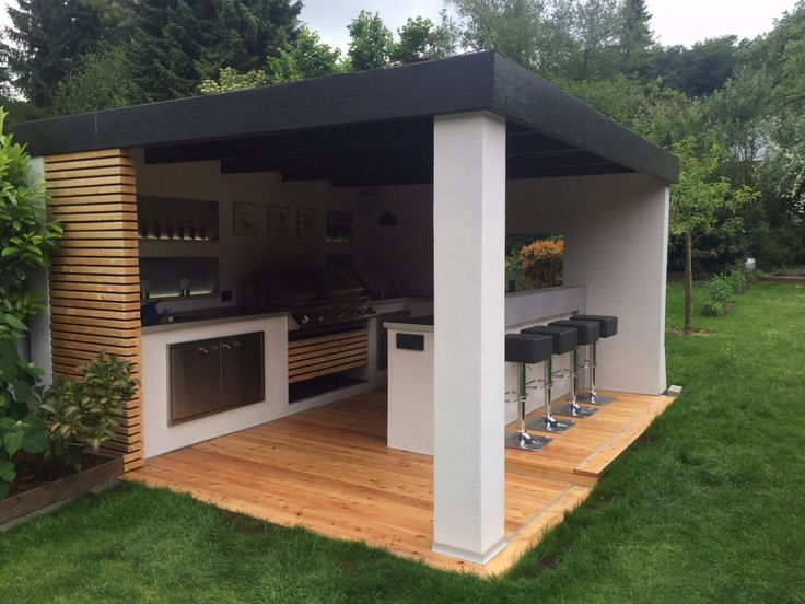 This outdoor kitchen with a window on ceiling to open up for natural lighting plus let smoke out when cooking/grilling!
