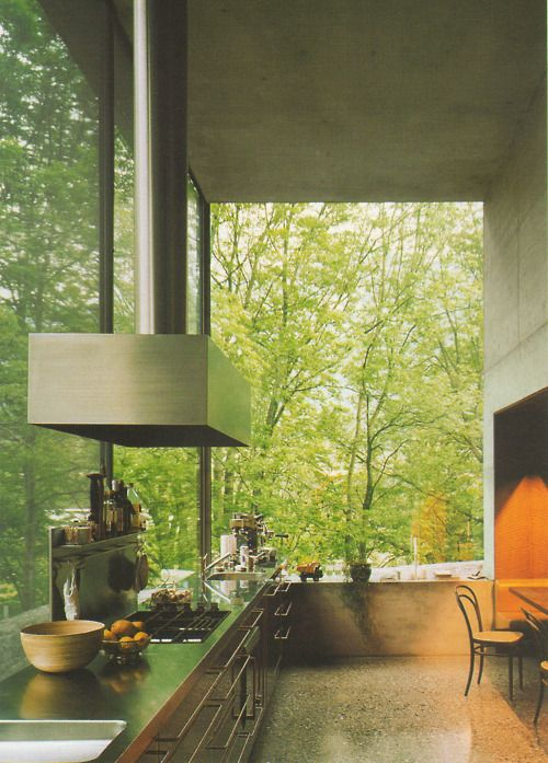 Kitchen inside Peter Zumthor's own house. Beautiful large sheets of glass.