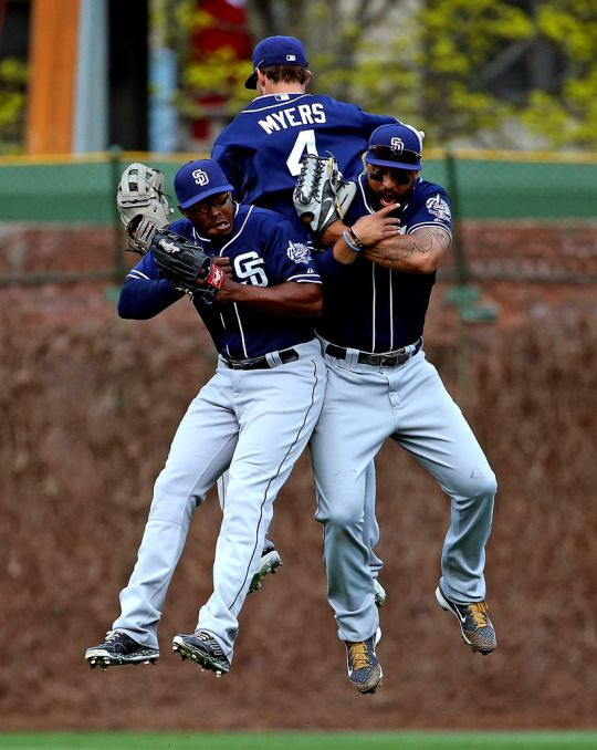 Will Venable #25, Wil Myers #4 and Matt Kemp #27 of the San Diego Padres celebrate a win over the Chicago Cubs at Wrigley Field on April 17, 2015 in Chicago