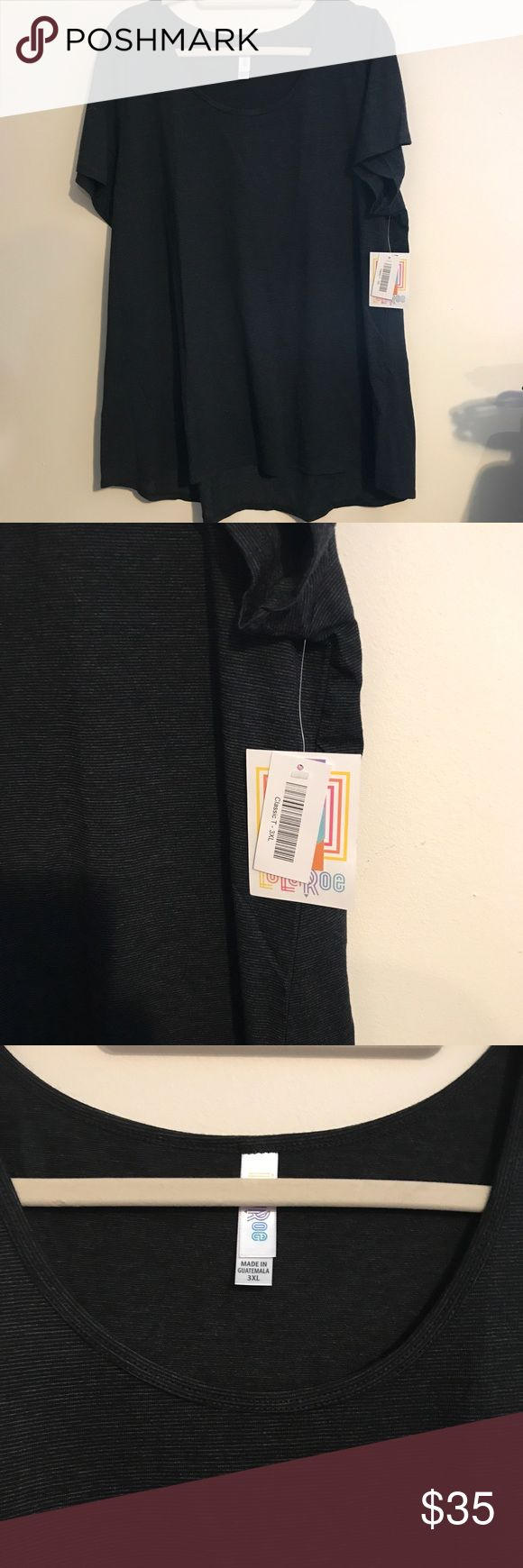 BNWT LuLaRoe 3X Classic T Dark Gray w/Microstripes BNWT LuLaRoe 3X Classic Tee Dark Gray w/ Microstripes. Coveted style in neutral color! This top is very lightweight and perfect for layering. Classic tees are just that, a classic short sleeve tee shirt, and a bit longer in back. LuLaRoe Tops Tees - Short Sleeve
