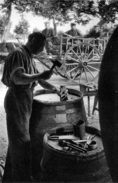 Man repairing casks in a street of Gevrey Chambertin (Burgundy ca 1930)