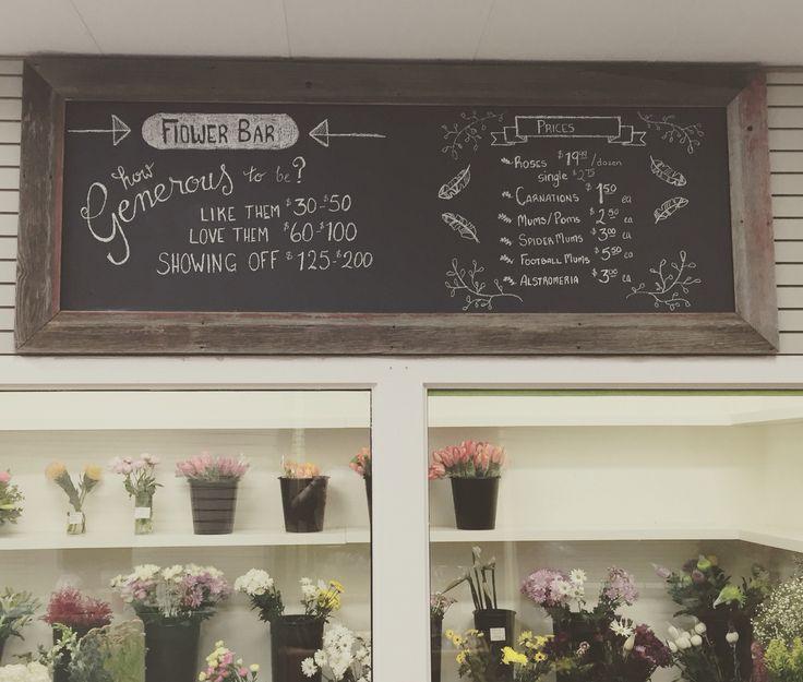 Our handmade barn wood framed chalkboard for above the cooler.