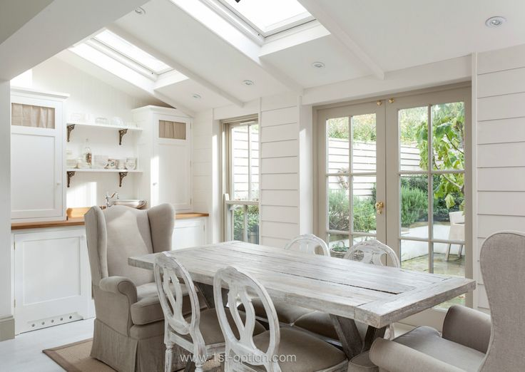 Lovely neutral and white dining room in this extension