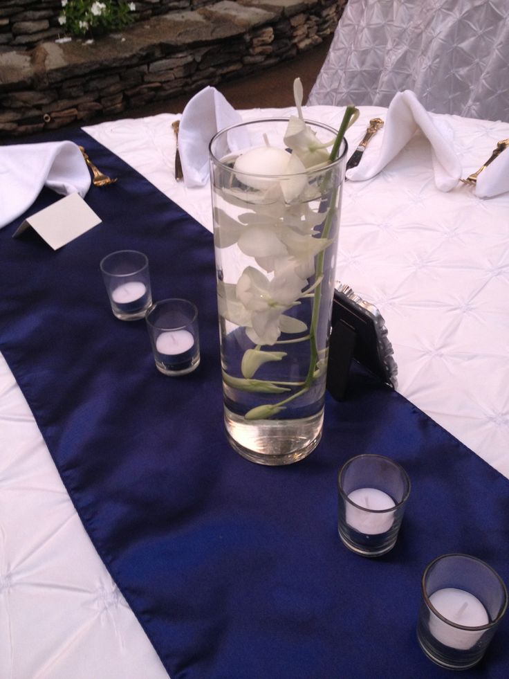 Navy Runner and Cylinder Centerpeice with flowers in water