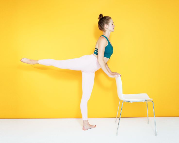 In this eight move barre workout inspired by ballerinas, you'll work your inner and outer thighs, glutes, and core, and all you need is a chair.