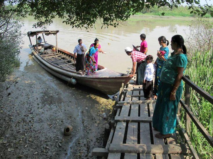 A small foot ferry crosses Pazundaung Creek behind the Mel Lamu Pagoda in Yangon, Myanmar (Burma).