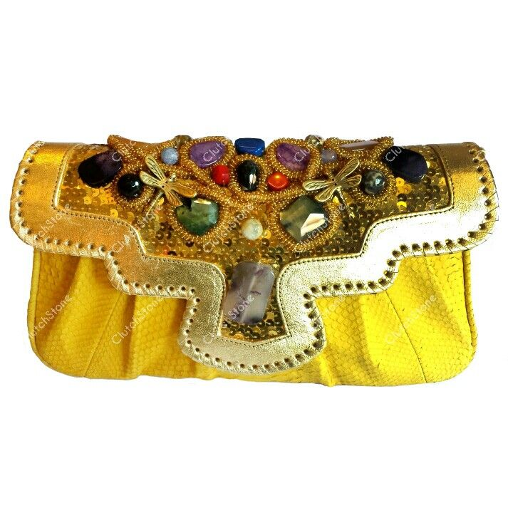 Clutch kipas python yellow size 17x34, suede cloth inside IDR : 1.500.000 free shipping all Indonesia