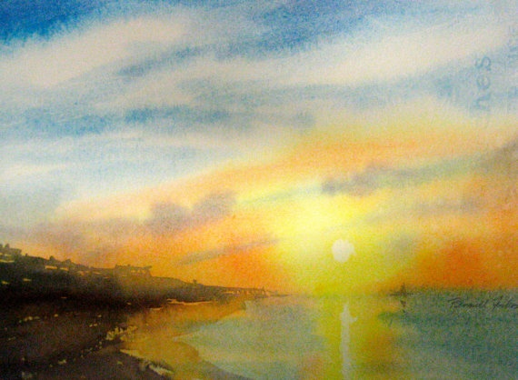original watercolor, Sunset at the Beach, distant buildings and pier, Blue sky clouds, yellow orange sunset reflected in ocean. $75.00, via Etsy.