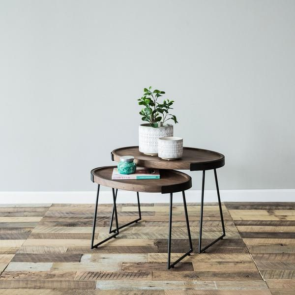 """The Hilton nesting tables feature funky hairpin legs that hold two oval acacia wood tops. Finished in a warm chestnut brown, we love these unique editions standing alone or paired together for dimension. Dimensions: LG- : 26"""" D: 18"""" H: 19"""" SM- L:22"""" D: 14"""" H: 16""""Materials: Acacia Wood, IronColors: Chestnut, Black"""