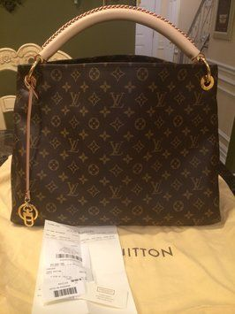 Louis Vuitton Artsy Mm Shoulder Bag. Get one of the hottest styles of the season! The Louis Vuitton Artsy Mm Shoulder Bag is a top 10 member favorite on Tradesy. Save on yours before they're sold out!
