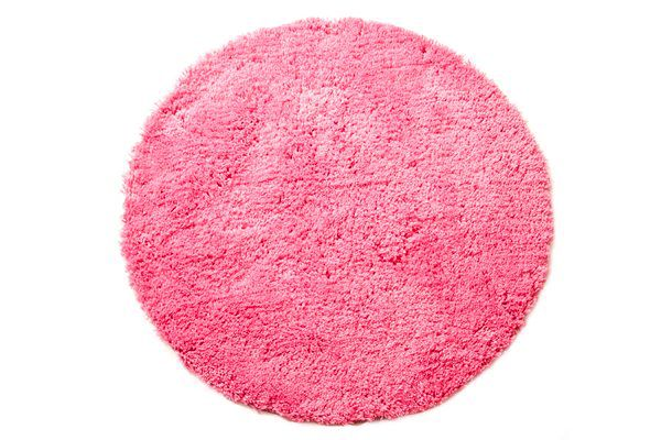 A shaggy round rug adds a solid block of colour to your girls bedroom. #patersonrose #girlsrooms #girlsbedroomdecor #rugs #kidsdecor #pink