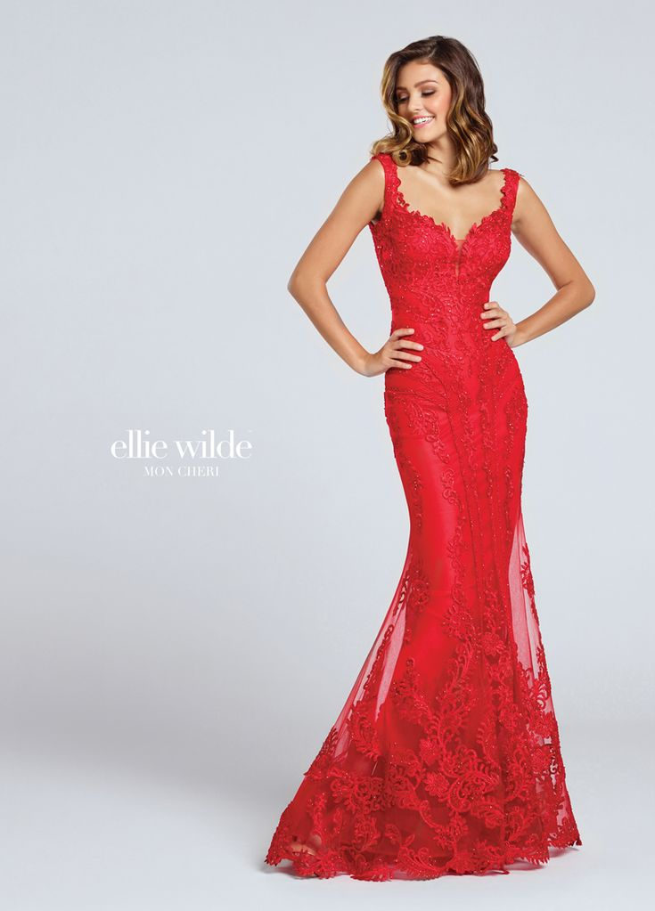 Encased in lace-appliqued tulle, the Ellie Wilde EW117046 prom dress features a two-strap mermaid-flared silhouette with a notched bodice and open back. A frilly trim adorns all edges of this full-length dress, while a modesty insert lies on the plunging sweetheart neckline. Mesh bands sweep off the side midriff toward the center skirt, creating an hourglass shape. Heat-set stones are sprinkled throughout, all the way to the brush train. #elliewilde #promdresses #promdress #prom #prom2018