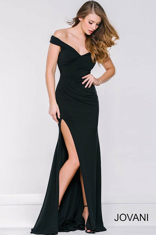 Off the shoulder sexy black form fitting long fully lined black prom gown with a ruched bodice and sexy thigh high slit available in red and white.