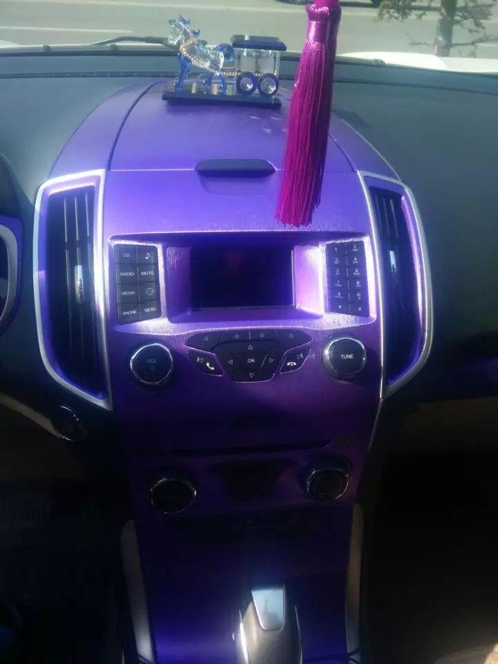 Purple car interior DIY with fiber purple wrap.