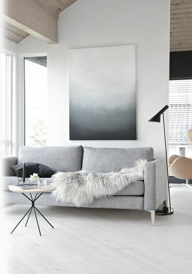 Minimalist living room using gray tones in artwork and furniture to accent space décor aid