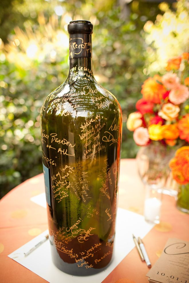 wedding idea: have guests sign wine bottle instead of guest book, then use as decoration in new home.
