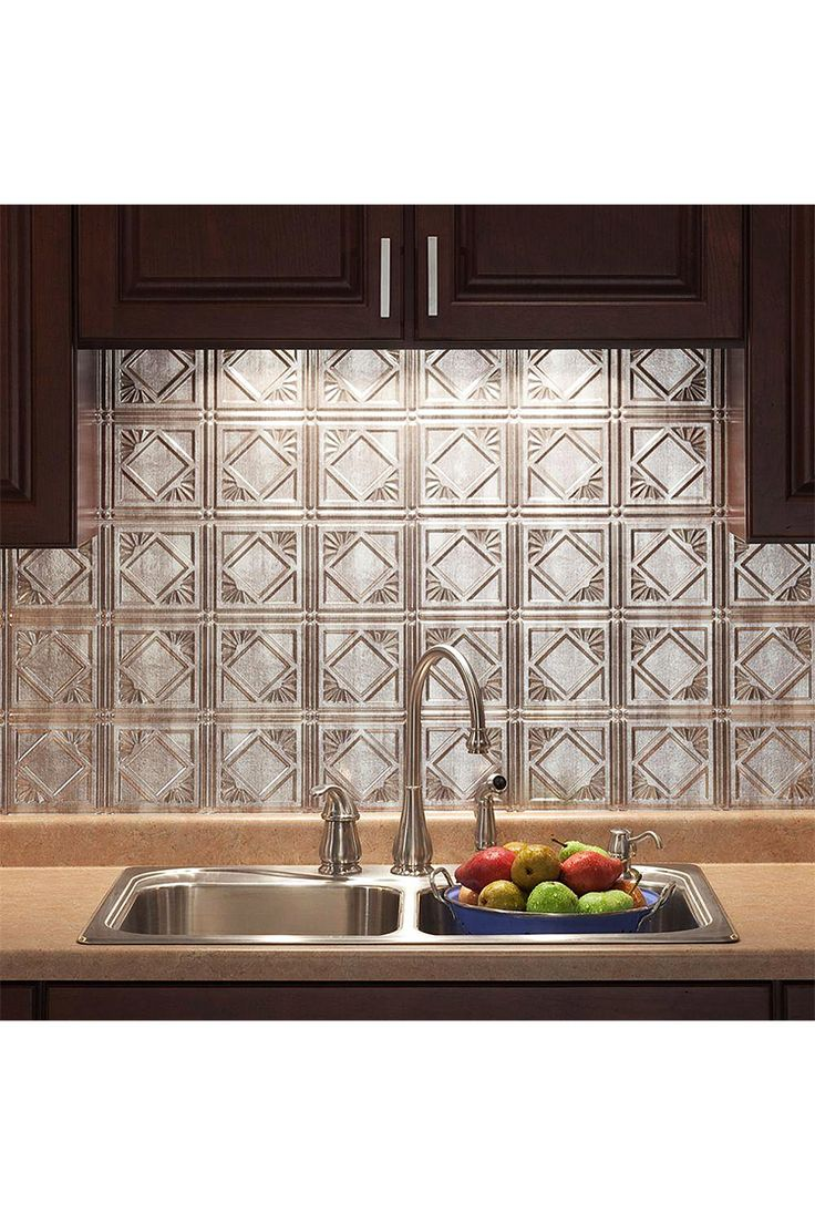 "This kitchen backsplash looks like vintage stamped tin. ""I found these panels, which look like old fashioned pressed metal tiles, and fell in love. They were easy to cut with heavy duty kitchen shears and easy to install."" --Home Depot customer elstein. Some customers have used these panels for ceilings, too!"