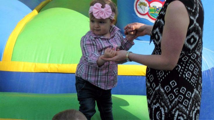 Olivia having fun in the bouncy house.