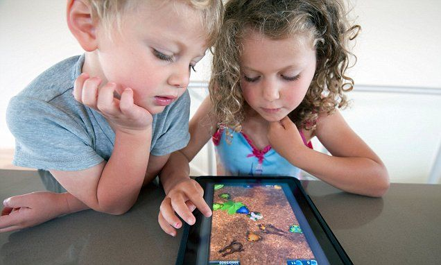 Children who use iPads could suffer from chronic neck and back pain