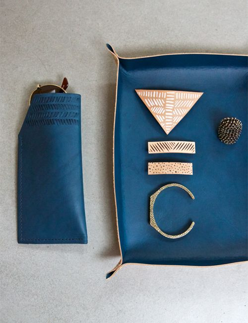 """Hand dyed two-tone leather tray measuring 9-1/2"""" long x 7-1/2"""" wide x 1""""  deep. Interior of tray is hand dyed blue and exterior is natural leather,  sealed and water-proofed. The tray is set with solid brass double cap  rivets that will darken with a patina over time.Perfect size"""