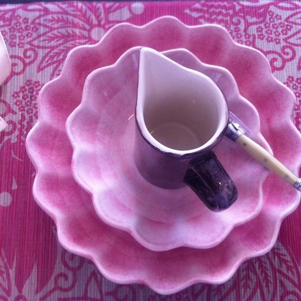 Floral pink placemat, rectangle size, featuring Mateus Oyster Bowls and Plum coloured jug. Avail at Table Tops in a Box.
