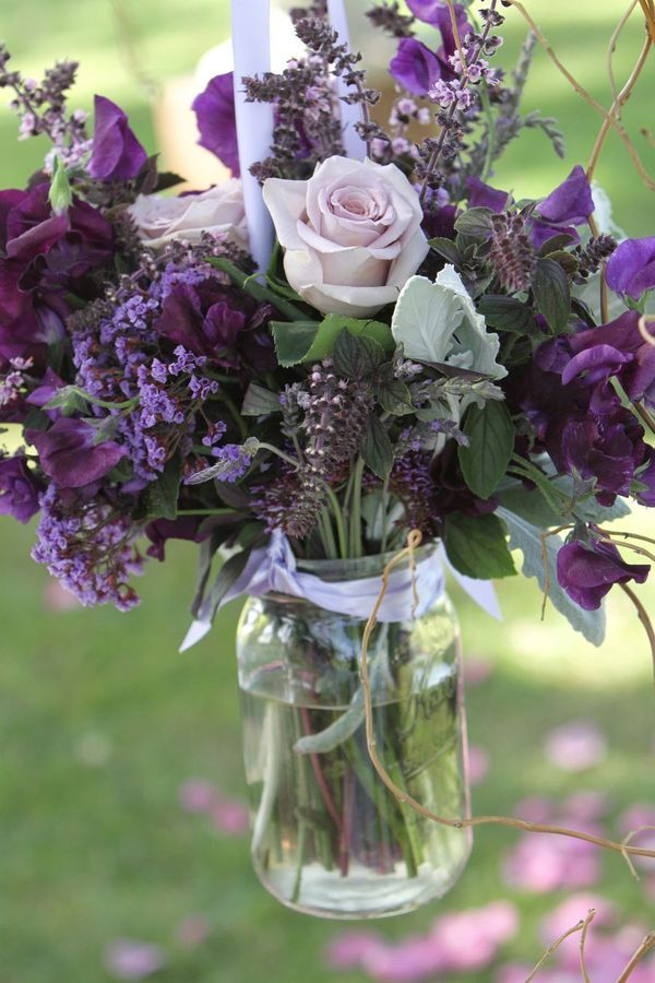 Lilac. One arrangement for grandpa with empty chair and note about heaven too far. Possibly with willow branches added.: