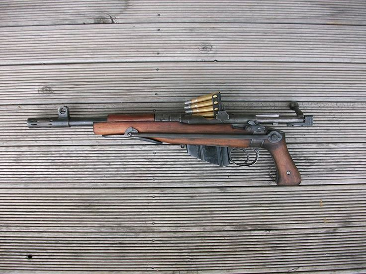 Some kind of Artillery Carbine styled, SMLE Lee-Enfield with a Pistol Grip and Skeletal Folding Stock.