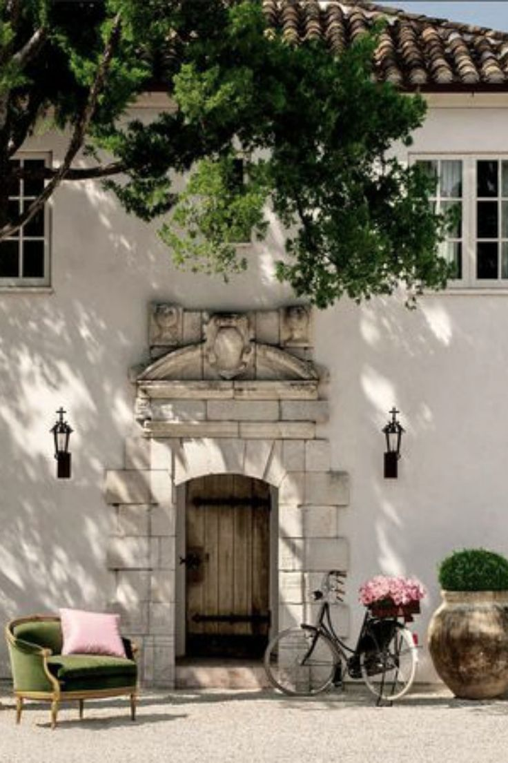 Breathtaking French Chateau Exterior | French Country Style | French Farmhouse inspiration | Limestone facade | Milieu magazine | Pamela Pierce Design | French courtyard | Rustic Antique Wood Door | Antique Roof Tiles