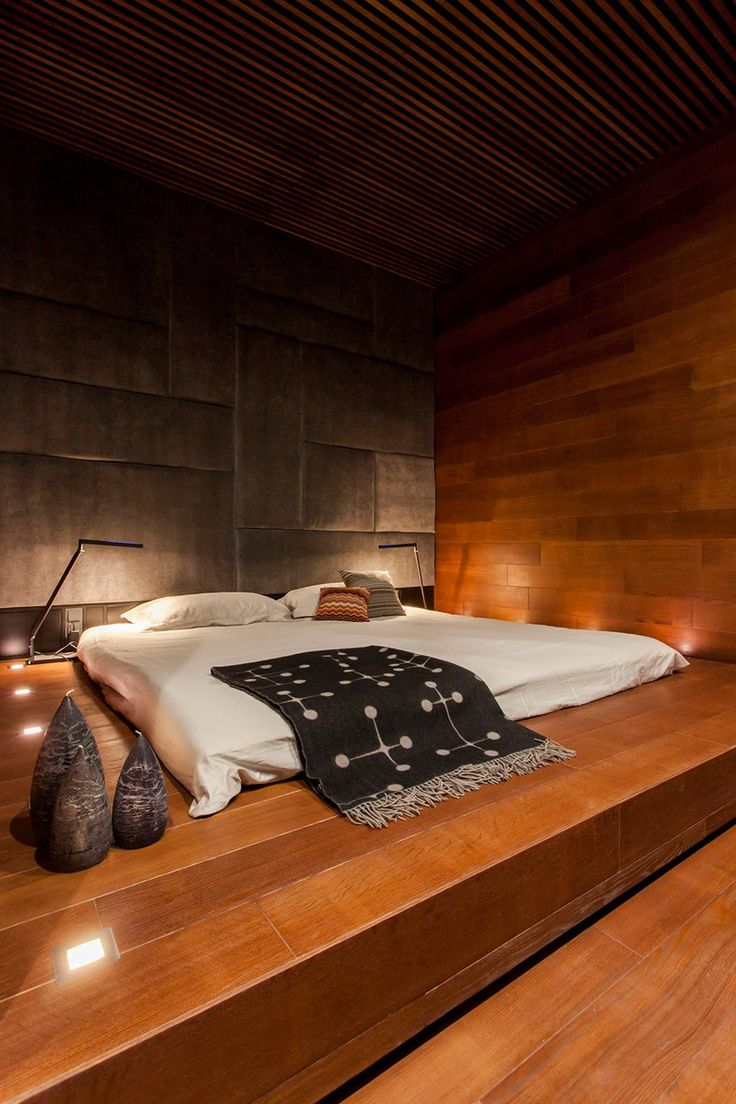 When interior design firm Soesthetic Group, were designing an apartment in Kiev, Ukraine, they were inspired by various elements of Thai decor, specifically the use of wood, and placing the bed on the floor.
