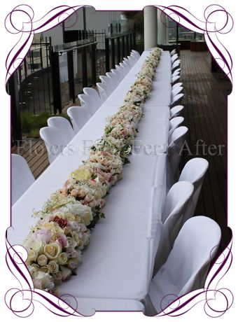 Vintage coloured silk flower table garland for hire in Melbourne and surrounds
