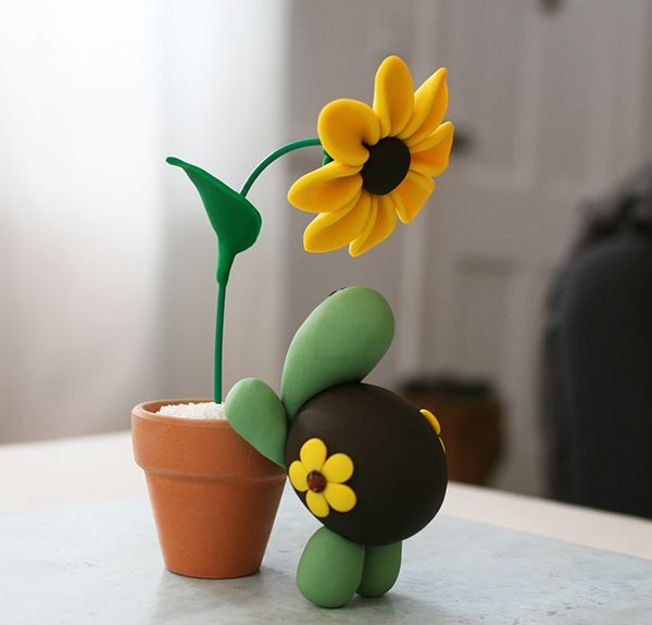 Polymer clay turtle and sunflower