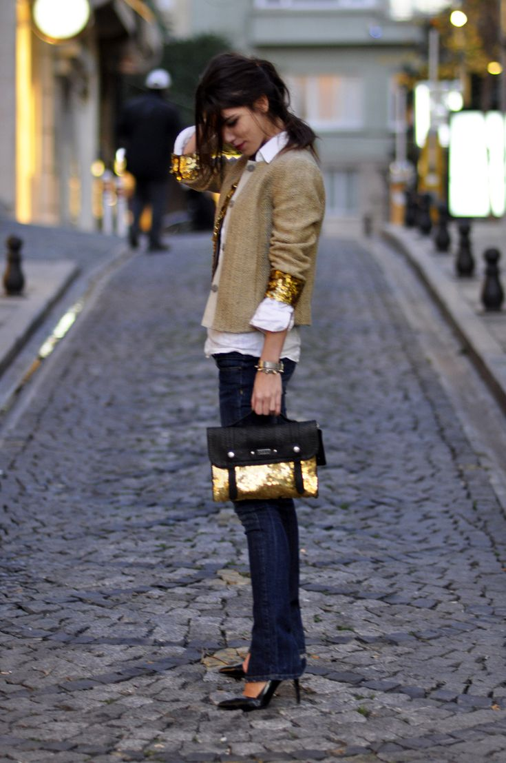 tan jacket w/gold sequined sleeves over white collared top & jeans w/adorable black/sequined bag