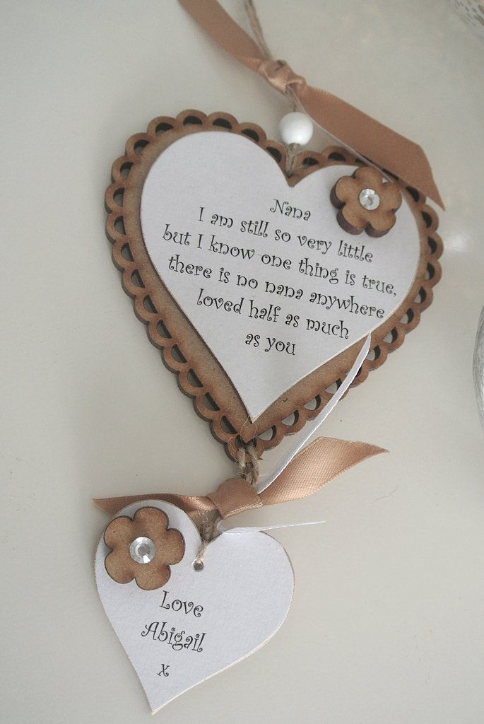 "Hanging Heart GiftThis heart makes a lovely gift for lots of occasions The name can be changed to Nan,Nana or Grandma etc Made from MDF wood and top heart measuring 100mm with scollop edging smaller 50mm hanging heart can have the name or names of sender Just add the name/names you require in ""Notes"" when going through the check out processTo finish the look it has added flowers and all hung with natural twine and bead Quote... I am still so very little but I know one thing is..."